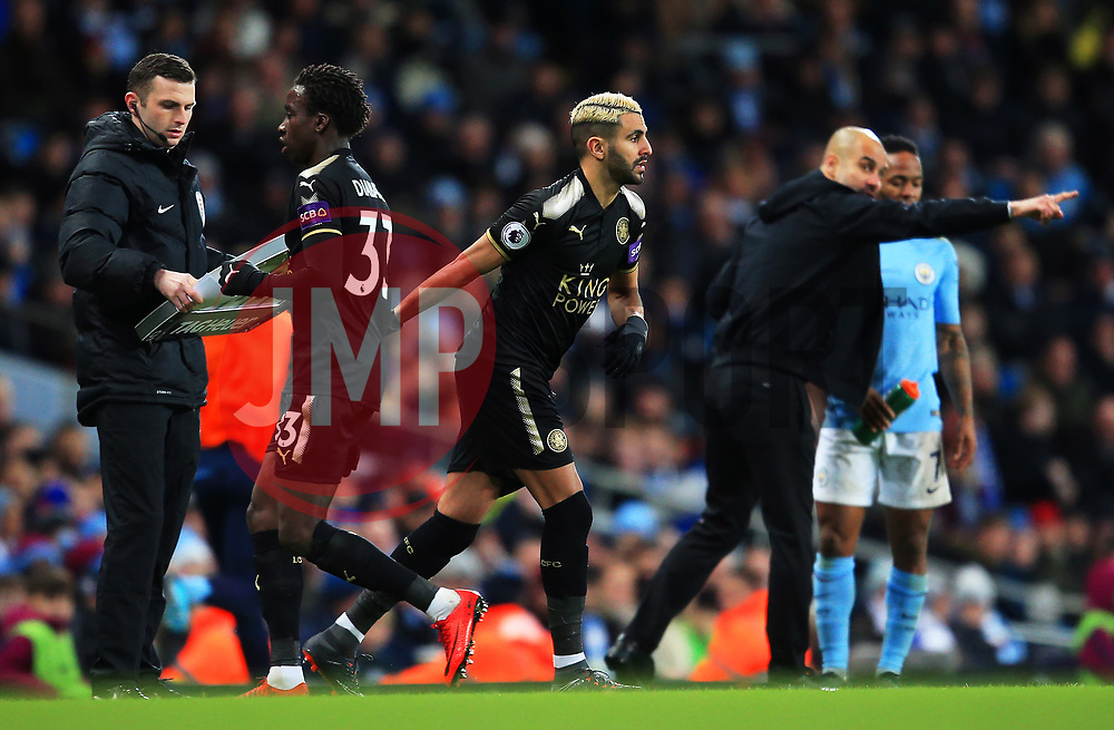 Manchester City manager Pep Guardiola looks on as Riyad Mahrez of Leicester City is introduced as a substitute - Mandatory by-line: Matt McNulty/JMP - 10/02/2018 - FOOTBALL - Etihad Stadium - Manchester, England - Manchester City v Leicester City - Premier League