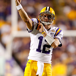 Sep 25, 2010; Baton Rouge, LA, USA; LSU Tigers quarterback Jarrett Lee (12) warms up prior to kickoff of a game against the West Virginia Mountaineers during the first half at Tiger Stadium.  Mandatory Credit: Derick E. Hingle