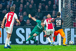 Ryan Babel #49 of Ajax and Lars Unnerstall #13 of PSV Eindhoven, Olivier Boscagli #28 of PSV Eindhoven in action during the match between Ajax and PSV at Johan Cruyff Arena on February 02, 2020 in Amsterdam, Netherlands