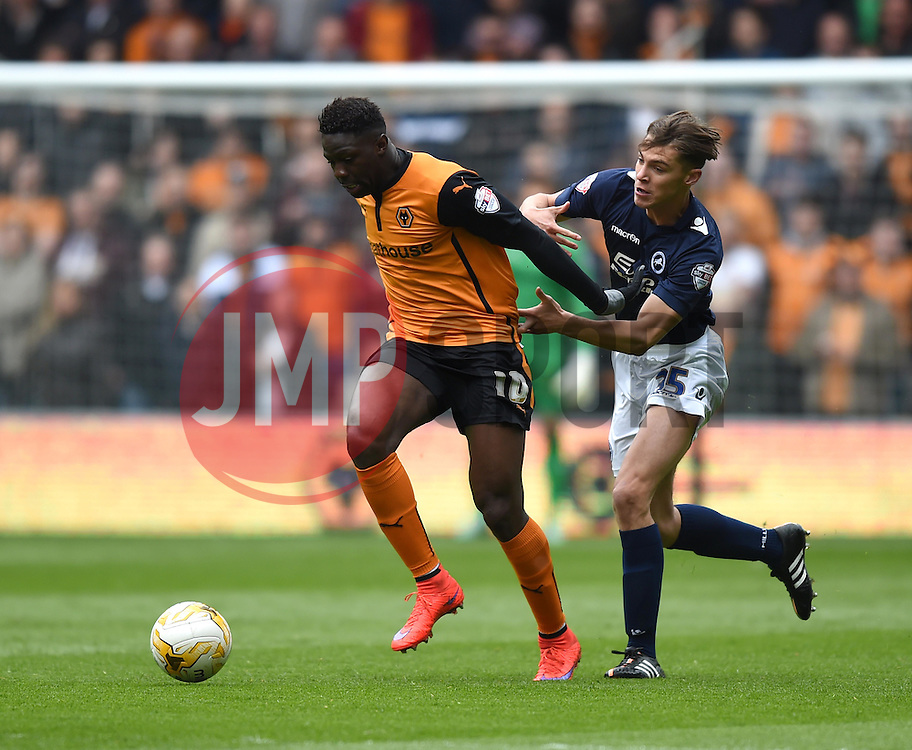 Millwall's Sid Nelson competes with Wolves' Bakary Sako - Photo mandatory by-line: Paul Knight/JMP - Mobile: 07966 386802 - 02/05/2015 - SPORT - Football - Wolverhampton - Molineux Stadium - Wolverhampton Wanderers v Millwall - Sky Bet Championship
