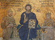 Detail of Deesis mosaic, 12th-13th century, showing Christ flanked by Emperor Constantine IX Monomachus (980-1055), and Empress Zoe (ruled Byzantine Empire 1042-55), Hagia Sophia, 532-37, by Isidore of Miletus and Anthemius of Tralles, Istanbul, Turkey. Hagia Sophia, The Church of the Holy Wisdom, has been a  Byzantine church and an Ottoman mosque and is now a museum. The current building, the third on the site, commissioned by Emperor Justinian I, is a very fine example of Byzantine architecture. The historical areas of the city were declared a UNESCO World Heritage Site in 1985. Picture by Manuel Cohen.