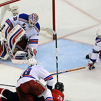28 April 2009:   New York Rangers goalie Henrik Lundqvist (30) makes a save on a shot  by Washington Capitals left wing Alexander Semin (28) who is taken  down to the ice by defenseman Marc Staal (18) in the 3rd period in the seventh game of the Eastern Conference NHL quarterfinal playoff game at the Verizon Center in Washington, D.C.  The Washington Capitals defeated the New York Rangers 2-1 in the Eastern Conference NHL quaterfinal playoff to advance to the second round of the playoffs.