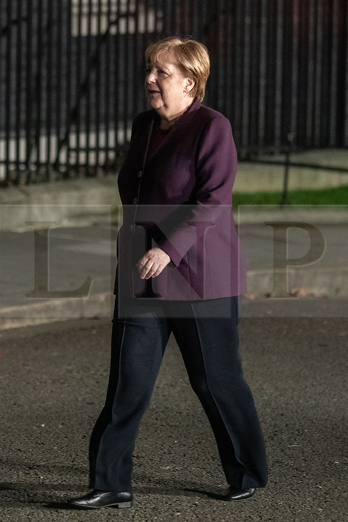© Licensed to London News Pictures. 03/12/2019. London, UK. Chancellor of Germany Angela Merkel arrives at 10 Downing Street for a reception hosted by UK Prime Minister Boris Johnson. International leaders are visiting the UK for to mark the 70th anniversary of the North Atlantic Treaty Organisation (NATO) Photo credit : Tom Nicholson/LNP