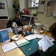 Produzione di pannelli di resina nel laboratorio dell'Istituto dei Ciechi a Milano, seguendo i criteri dell'alfabeto Braille. Con questi pannelli i ciechi possono leggere, e conoscere i monumenti attraverso il tatto..Ultimi ritocchi alle pagine di un libro per bambini: inserimento di un filo colorato per simulare la corda di un palloncino.    ..Production of resin panels in the laboratory of the Institute of the Blind people to Milan, following the criteria of the Braille alphabet. With these panels the blind people can read, and know monuments through the tact..Last alterations to the pages of a book for children: insertion of a colorful wire in order to simulate the rope of a balloon.