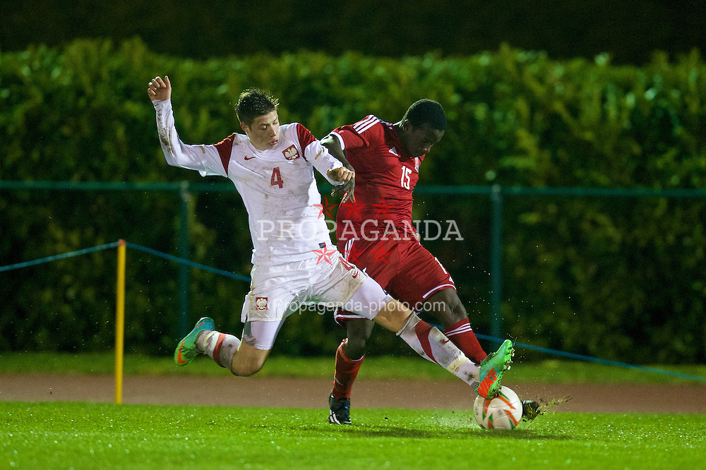 CONNAH'S QUAY, WALES - Thursday, March 20, 2014: Wales' Ibi Sosani in action against Poland's Bartlomiej Gajda during the Under-15's International Friendly match at the Deeside Stadium. (Pic by David Rawcliffe/Propaganda)