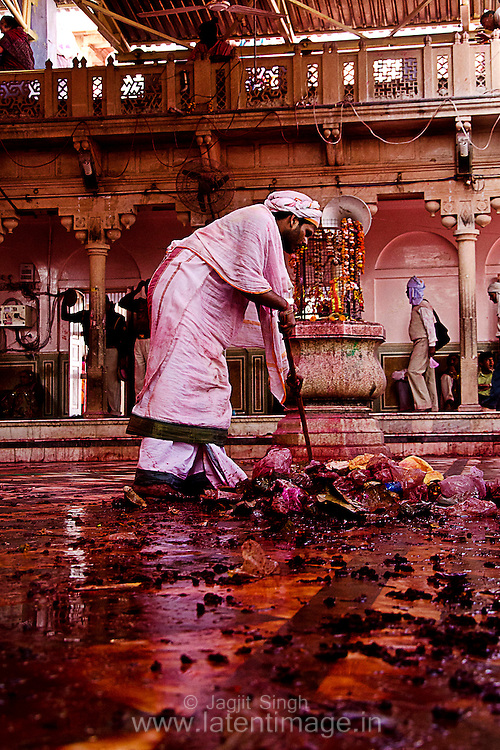 A man cleaning the temple premises after Samaj at Barsana, Mathura. Braj ki Holi