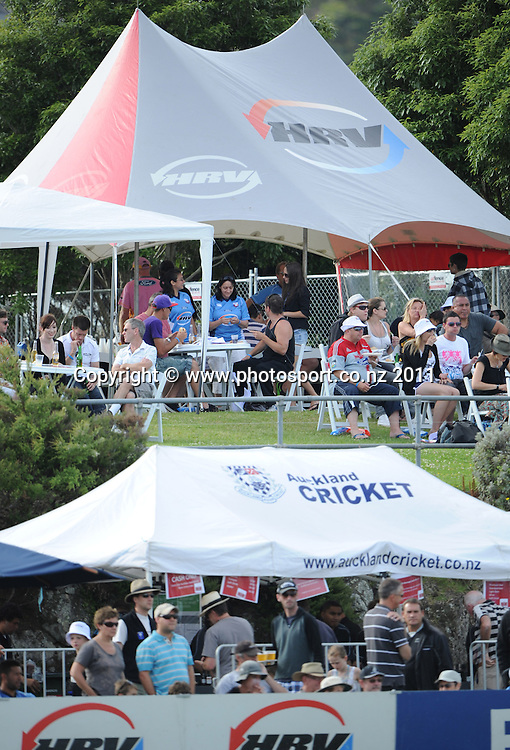 A record crowd of cricket fans watch the HRV Twenty20 Cricket match between the Auckland Aces and Northern Knights at Colin Maiden Oval in Auckland on Monday 26 December 2011. Photo: Andrew Cornaga/Photosport.co.nz