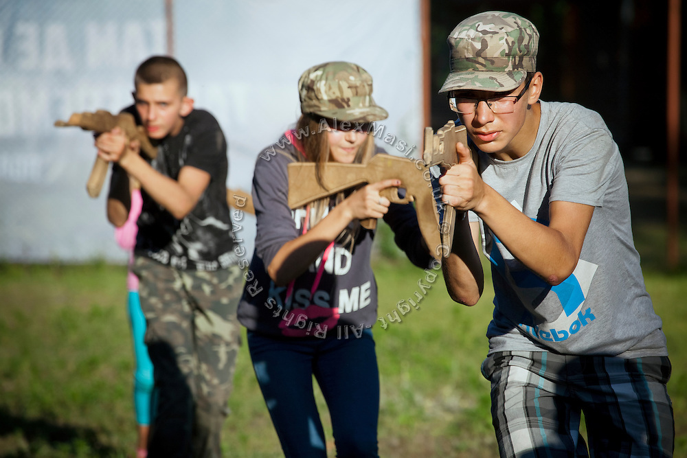 Kachur, 13, originally from the city of Kharkiv, eastern Ukraine, is participating to the nationalist Azov Battalion Summer Children's Camp near the village of Buzova, 10 km west of Kiev, the capital of Ukraine. This is Kachur's second time at an Azov summer camp.