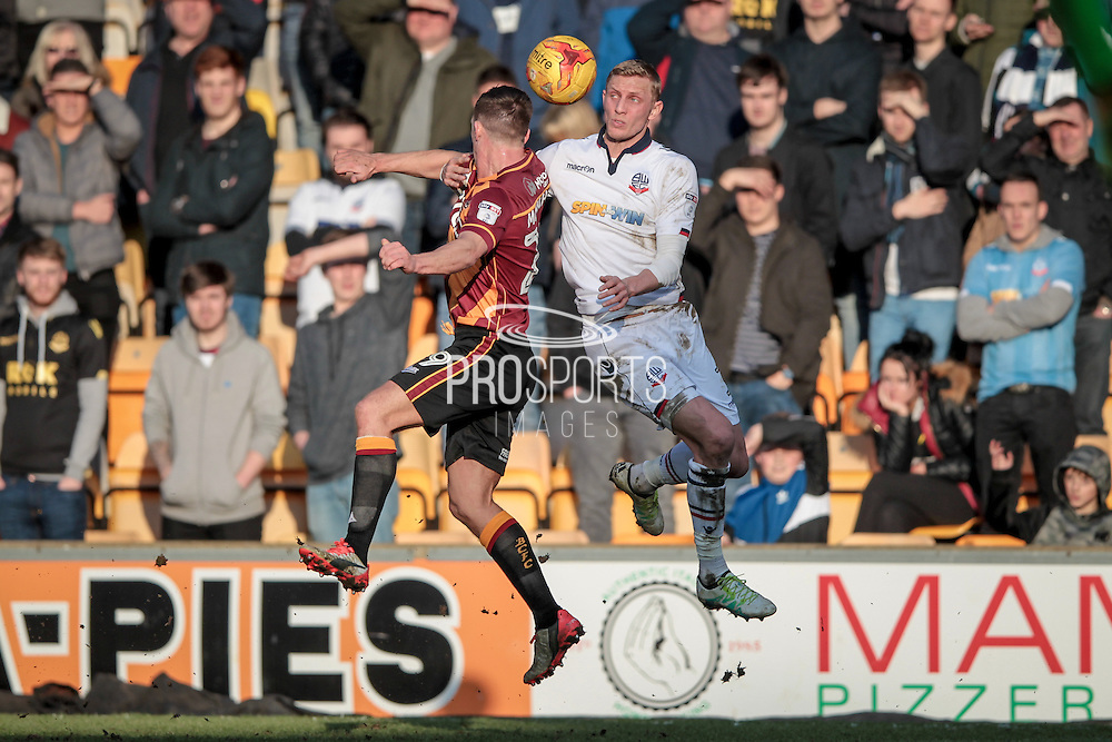 Dean Moxey (Bolton Wanderers) wins a header during the EFL Sky Bet League 1 match between Bradford City and Bolton Wanderers at the Coral Windows Stadium, Bradford, England on 18 February 2017. Photo by Mark P Doherty.