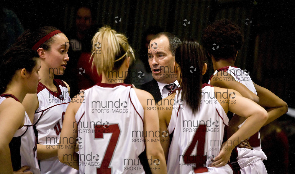 (Ottawa, ON---6 March 2010) University of Ottawa Gee-Gees head coach Andy Sparks gives instructions to his players in the 2010 Ontario University Athletics (OUA) women's basketball championship. The University of Windsor Lancers defeated the University of Ottawa Gee-Gees 83-55 to win the 2010 conference title.