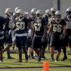 Jul 26, 2013; Metairie, LA, USA; New Orleans Saints linebacker Will Smith (91) with teammates linebacker Curtis Lofton (50) and defensive end David Hawthorne (57) during the first day of training camp at the team facility. Mandatory Credit: Derick E. Hingle-USA TODAY Sports