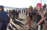Deb Mosley waits to start the swim at Lake Berryessa. Wearing a pink cap for being a cancer survivor.  Mosley's time was 2 hours 3 minutes for the half-mile swim, 15-mile bike and 4-mile run...Photo by Jason Doiy.10-9-04.027-2004.