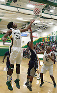 Northmont senior Jamal Trammell (23) goes after the ball at the basket in the third quarter as the Fairmont Firebirds play the Northmont Thunderbolts at Northmont High School in Clayton, Friday, December 16, 2011.