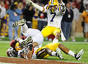 Photo by Gary Cosby Jr.    LSU defensive back Eric Reid pulls the ball away from Alabama receiver Michael Williams near the LSU goal line.  LSU defender Tyrann Mathieu celebrates the pick.  The play proved decisive in LSU's 9-6 overtime victory.