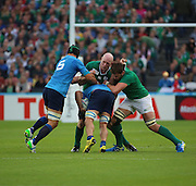 Ireland second row and captain Paul O'Connel trying to stop an Italian attack during the Rugby World Cup Pool D match between Ireland and Italy at the Queen Elizabeth II Olympic Park, London, United Kingdom on 4 October 2015. Photo by Matthew Redman.