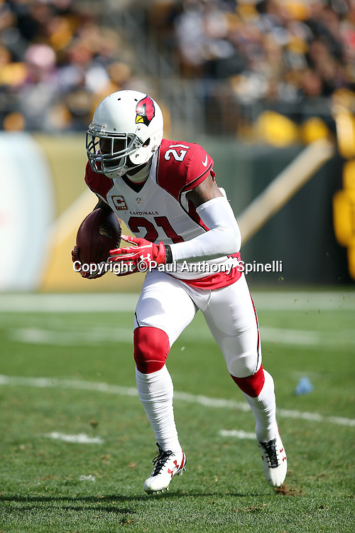 Arizona Cardinals cornerback Patrick Peterson (21) returns a second quarter punt during the 2015 NFL week 6 regular season football game against the Pittsburgh Steelers on Sunday, Oct. 18, 2015 in Pittsburgh. The Steelers won the game 25-13. (©Paul Anthony Spinelli)