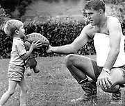 Colin Meads playing with 3 year old Wayne Cooke taken on 13 March 1972 while Colin was recovering from a broken back sustained in a motor vehicle accident.<br /> Copyright photo: Ron Cooke / www.photosport.nz