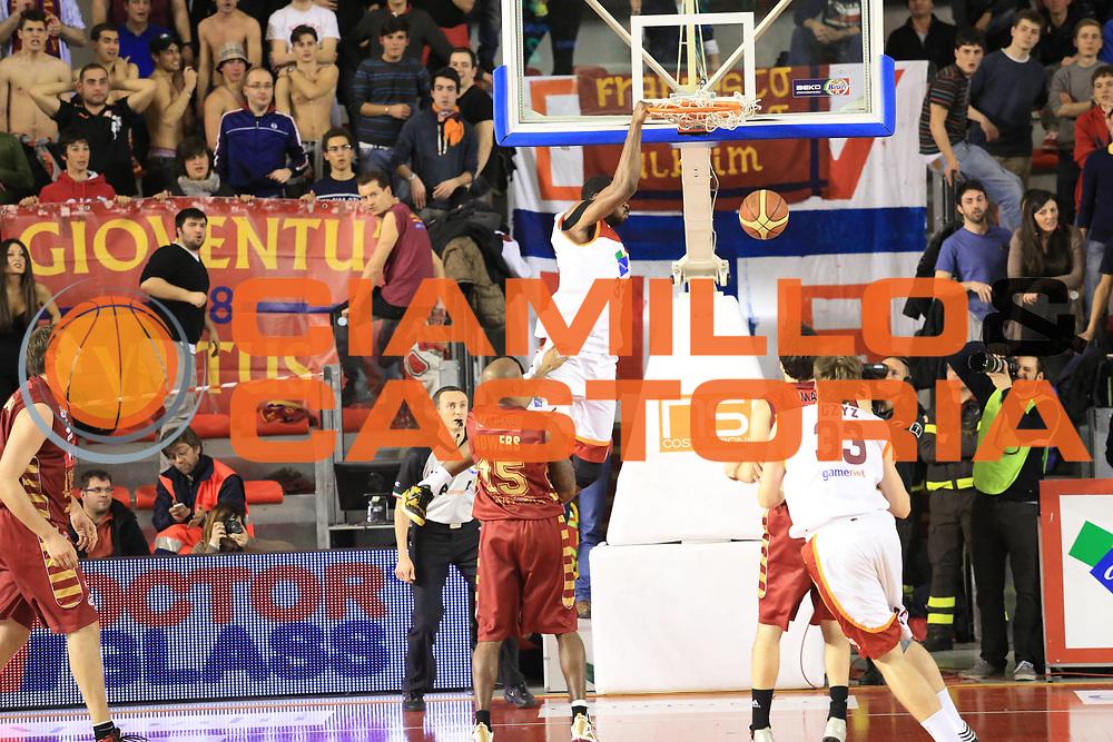 DESCRIZIONE :  Roma Lega A 2012-13 Acea Roma Umana Reyer Venezia<br /> GIOCATORE : Gani Lawal<br /> CATEGORIA : schiacciata sequenza controcampo<br /> SQUADRA : Acea Roma<br /> EVENTO : Campionato Lega A 2012-2013 <br /> GARA : Acea Roma Umana Reyer Venezia<br /> DATA : 16/03/2013<br /> SPORT : Pallacanestro <br /> AUTORE : Agenzia Ciamillo-Castoria/M.Simoni<br /> Galleria : Lega Basket A 2012-2013  <br /> Fotonotizia : Roma Lega A 2012-13 Acea Roma Umana Reyer Venezia<br /> Predefinita :