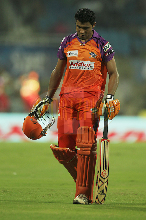 Ravindra Jadeja of Kochi Tuskers Kerala walks back dejectedly after getting out during  match 10 of the Indian Premier League ( IPL ) Season 4 between the Pune Warriors and the Kochi Tuskers Kerala held at the Dr DY Patil Sports Academy, Mumbai India on the 13th April 2011..Photo by BCCI/SPORTZPICS