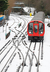 © Licensed to London News Pictures. 11/12/2017. Amersham, UK. A London Underground train surrounded by snow at Amersham Station in Buckinghamshire. Transport is being heavily affected across parts of the islands and southern England with British Airways cancelling 30 flights before 10am this morning. Photo credit: Tom Nicholson/LNP