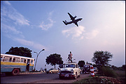 Watching airplanes take off and land, Indira Gandhi Airport, New Delhi. Financial Times, London