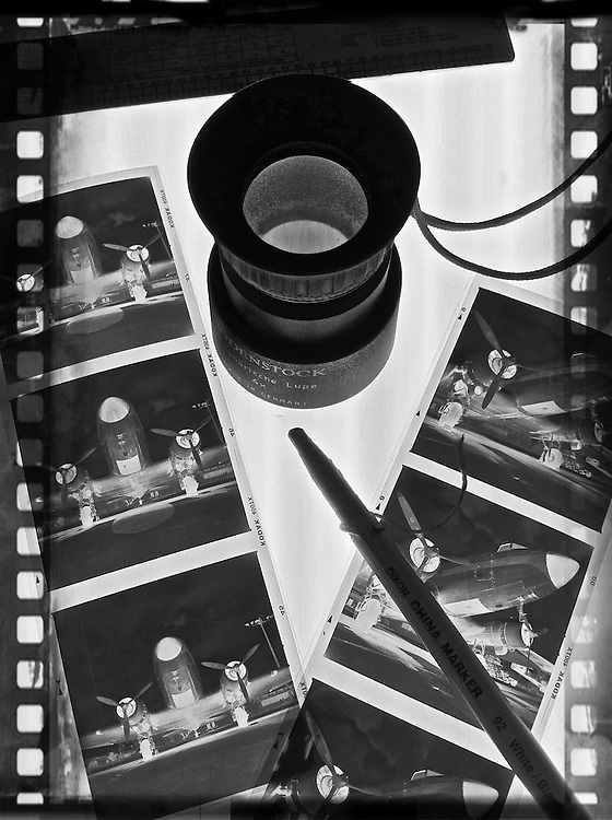 black and white negatives on the light table with loupe cellphone photography,Iphone pictures,smartphone pictures