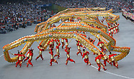 BEIJING, CHINA:  Chinese artist perform the dragon dance inside  the National Stadium during the 2008 Olympiad Opening Ceremony in Beijing, China on Friday, 8/8/08. Thousands of Chinese dancers performed during the event.  ©2008 Johnny Crawford