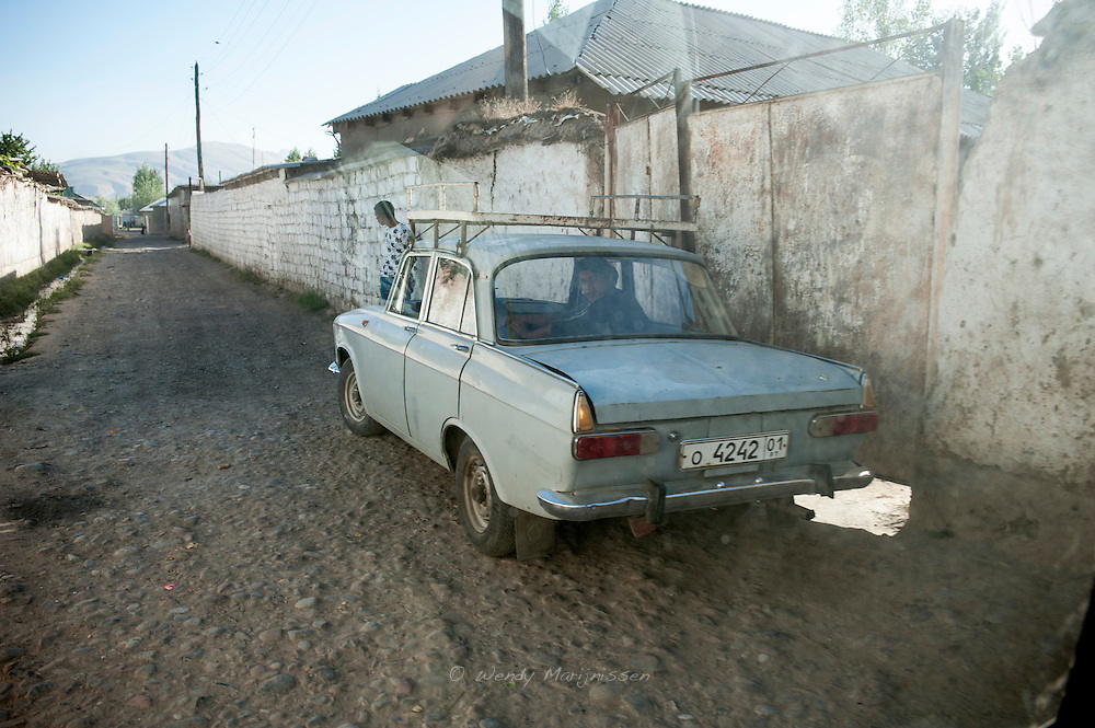 A car in the street in the gypsy quarter of the village where MSF's 11 year old patient Rukshona lives. Villagers hardly venture into this part of town because of the bad reputation of the gypsy families.
