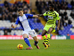 Yeovil Town's Joel Grant closes down Birmingham City's Oliver Lee - Photo mandatory by-line: Dougie Allward/JMP - Tel: Mobile: 07966 386802 18/01/2014 - SPORT - FOOTBALL - St Andrew's Stadium - Birmingham - Birmingham City v Yeovil Town - Sky Bet Championship