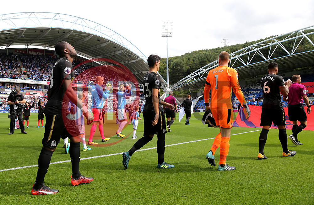 Newcastle United and Huddersfield Town players walk out on to the pitch before kick off - Mandatory by-line: Matt McNulty/JMP - 20/08/2017 - FOOTBALL - John Smith's Stadium - Huddesfield, England - Huddersfield Town v Newcastle United - Premier League
