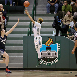 Feb 3, 2016; New Orleans, LA, USA; Tulane Green Wave guard Taylor Emery (14) shoots overConnecticut Huskies center Natalie Butler (51) during the second quarter of a game at the Devlin Fieldhouse. Mandatory Credit: Derick E. Hingle-USA TODAY Sports
