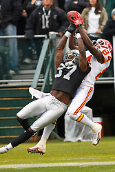 November 7, 2010; Oakland, CA, USA;  Oakland Raiders cornerback Chris Johnson (37) is called for pass interference on a reception attempt by Kansas City Chiefs wide receiver Chris Chambers (84)during the first quarter at Oakland-Alameda County Coliseum.