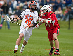 Virginia Cavaliers M Brian Carroll (36) is defended by Maryland Terrapins SSM Dean Hart (16).  The #9 ranked Maryland Terrapins fell to the #1 ranked Virginia Cavaliers 10 in 7 overtimes in Men's NCAA Lacrosse at Klockner Stadium on the Grounds of the University of Virginia in Charlottesville, VA on March 28, 2009.