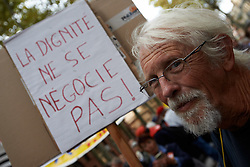 October 9, 2018 - Toulouse, France - A man looks as he carries a placard reading 'Dignity isn't negociable'. Trade unions (CGT, FO, SUD, etc.) called people, workers, retired people, civil servants to demonstrate against French President Macron's economic and social policies. Toulouse. France. October 9th 2018. (Credit Image: © Alain Pitton/NurPhoto via ZUMA Press)
