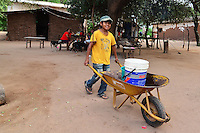 Guarani boy carrying water