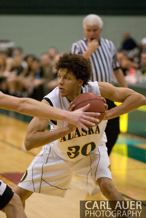 1/6/2006: Sophomore forward Cameron Burney (30) of the UAA Seawolves protects the ball as Anchorage goes on to beat the visiting Central Washington Wildcats, 80-60 at the Wells Fargo Sports Complex on the campus of UAA.<br />