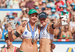 03.08.2013, Klagenfurt, Strandbad, AUT, A1 Beachvolleyball EM 2013, Finale Damen, Spiel 72, im Bild Laura Ludwig 1 GER (rechts), Kira Walkenhorst 2 GER// during Gold Medal Match match 72 of the A1 Beachvolleyball European Championship at the Strandbad Klagenfurt, Austria on 2013/08/03. EXPA Pictures © 2013, EXPA Pictures © 2013, PhotoCredit: EXPA/ Mag. Gert Steinthaler
