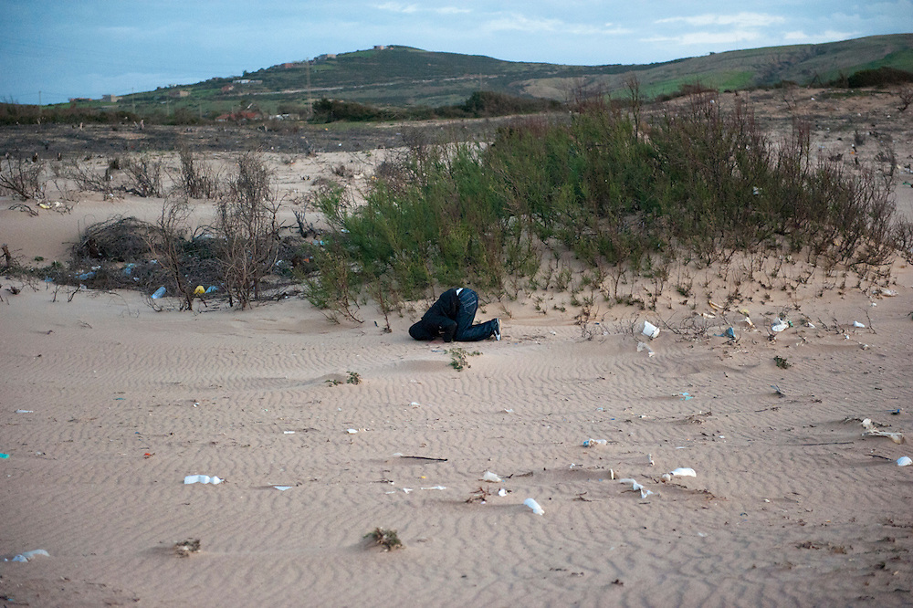 A member of Ennahda prays on the beach north of Sejenane.<br />