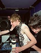 Oliver Von Blitzkrieg, DJ at The Junk Club, taking a drag off someone's cigarette, Southend, UK 2006