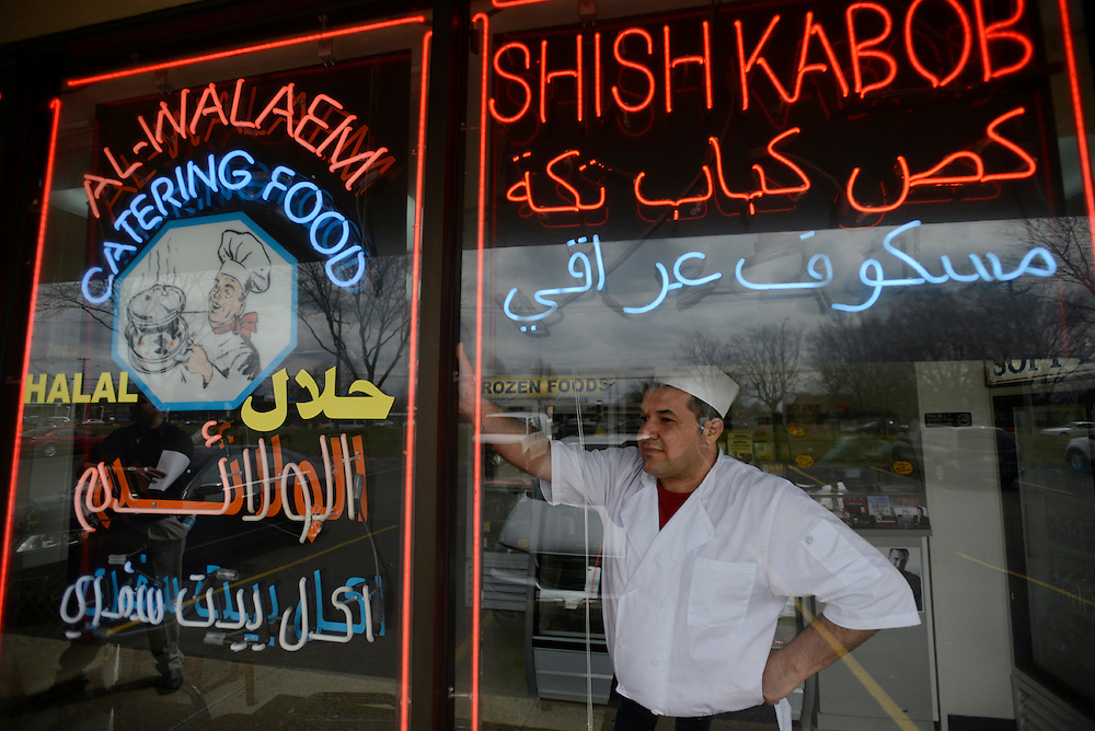 The Iraqi owner of the Al-Walaem kabob restaurant. Most Iraqi refugees were well educated, middle-class families at home. Regardless of their education and work experience in Iraq, many refugees are forced to start small businesses such as restaurants, gas stations, convenience stores and liquor stores in order to make a living. Sterling Heights, MI, USA. 15/04/2013.
