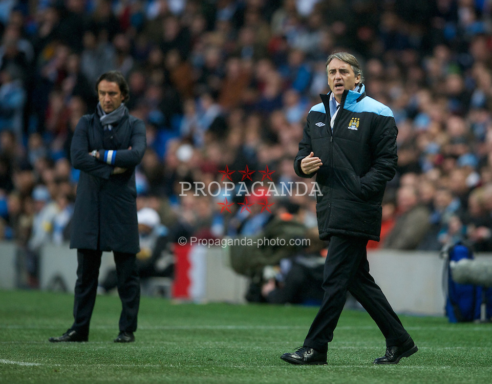 MANCHESTER, ENGLAND - Wednesday, February 22, 2012: Manchester City's manager Roberto Mancini and FC Porto's head coach Vitor Pereira during the UEFA Europa League Round of 32 2nd Leg match at City of Manchester Stadium. (Pic by David Rawcliffe/Propaganda)