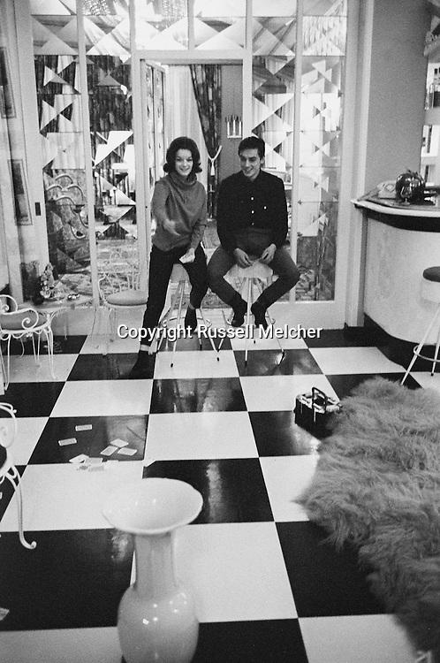 1959. Playing a card game on the floor<br /> inside Romy's mother's home.<br /> Romy was much better at this game than Alan.<br /> <br /> 1959. Jeu de cartes sur le plancher<br /> &agrave; l'int&eacute;rieur de la maison de la m&egrave;re de Romy .<br /> Romy Schneider &eacute;tait beaucoup mieux &agrave; ce jeu qu' Alain Delon .