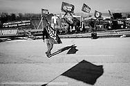 Pomigliano D'Arco, Italia - Lavoratori dello stabilimento FIAT di Pomigliano D'Arco presidiano le via d'accesso alla fabbrica per protestare contro la presentazione della nuova Panda che avverrà il 14 dicembre 2011 sotto gli occhi dell'amministratore delegato Sergio Marchionne e John Elkann. Gli operai protestano anche per il clamore mediatico che si è creato intorno all'evento che sta facendo in modo da far passare in secondo piano il disagio della classe operaia di Pomigliano e dei lavoratori FIAT in generale..Ph. Roberto Salomone Ag. Controluce.ITALY - FIAT worker of the Pomigliano D'Arco plant protest against the presentation of the new Panda car Produced by FIAT in Pomiglian D'Arco on December 13, 2011. Workers criticize the mediatic attention on the presentation of the car that will focus the attention not on the real problems they are facing.