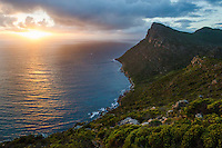 Fynbos covered ridges of the Table Mountain National Park, overlooking False Bay at dawn, Cape Point, Table Mountain National Park, Western Cape, South Africa.