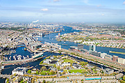 Nederland, Noord-Holland, Amsterdam, 09-04-2014;<br /> Overzicht Marineterrein en omgeving, linksbeneden het Scheepvaartmuseum, Kattenburg, de IJtunnel en museum Nemo, verder Oosterdokseiland,  Centraal Station. Boven in beeld het IJ, Amsterdam West en Noord.<br /> View Navy area (center) and the National Maritime Museum (white building), left Museum Nemo, central station, newly constructed buildings. Top right the North of Amsterdam. <br /> luchtfoto (toeslag op standard tarieven);<br /> aerial photo (additional fee required);<br /> copyright foto/photo Siebe Swart