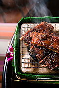 Kradook moo aob sauce, CHILI GLAZED BABY BACK RIBS: Spice rubbed pork ribs glazed with Issaya house-blended chili paste at Issaya Siamese Club