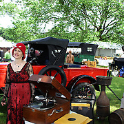 Parker and Gwen Ackley in period costume at the Greenwich Concours d'Elegance Festival of Speed and Style featuring great classic vintage cars. Roger Sherman Baldwin Park, Greenwich, Connecticut, USA.  2nd June 2012. Photo Tim Clayton