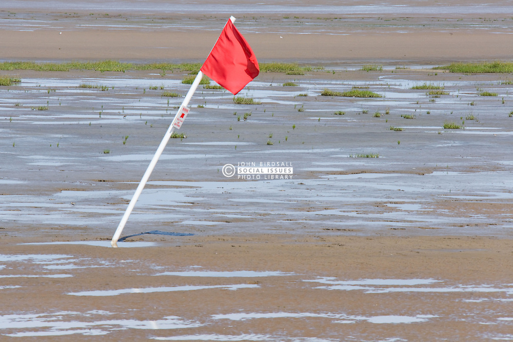 Red flag on Crosby beach; Liverpool; England warning swimmers 'No Bathing' in this area,