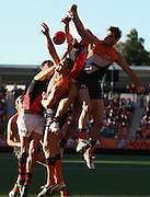 Bombers and Giants players contest a mark during the 2013 AFL Round 17 match between the GWS Giants and the Essendon Bombers at Skoda Stadium, Sydney on July 20, 2013. (Photo: Craig Golding/AFL Media)