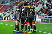 Brentford celebrate as Brentford midfielder Kamohelo Mokotjo scores a goal to take the lead 0-1 during the EFL Sky Bet Championship match between Rotherham United and Brentford at the AESSEAL New York Stadium, Rotherham, England on 19 January 2019.